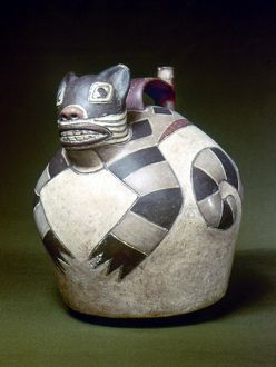 PERU: NAZCA WHISTLING JAR. Ceramic whistling water jar with a sculpted cat on the top