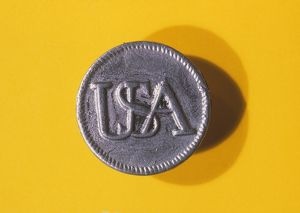 Pewter button from the uniform of an American Revolutionary War soldier.
