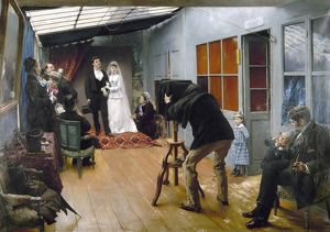 PHOTOGRAPHY STUDIO, c1878. 'Wedding Party at a Photographer's Studio.' Oil on canvas