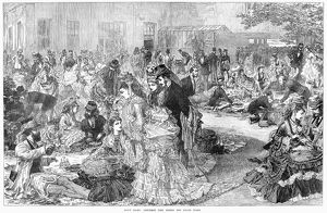 PICNIC AT THE RACES, 1872. A luncheon on the lawn behind the grandstand at the