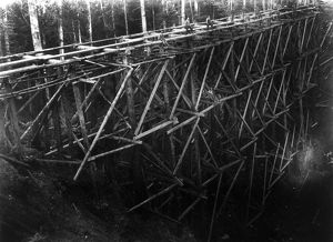 PILE BRIDGE, c1914. Workers constructing a pile bridge which is estimated to be