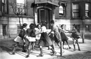 Playing ring around a rosie in the Black Belt neighborhood of Chicago: photograph