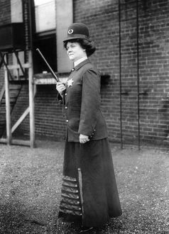 POLICEWOMAN, 1909. A suffragette posed as a female police officer in Cincinnati, Ohio
