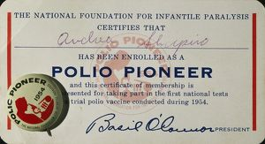 POLIO CERTIFICATE, 1954. American 'Polio Pioneer' certificate and lapel