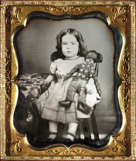 Portrait of a girl holding a black rag doll. Daguerreotype, c1852.