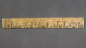 POTAWATOMI MEDICINE STICK. Stick containing many recipes for medicinal cures, used