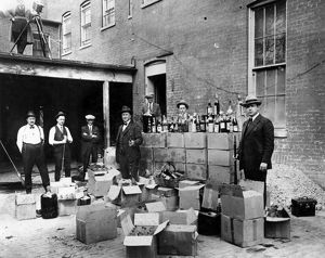 PROHIBITION, 1922. Revenue agents with confiscated bootleg liquor at Washington, D
