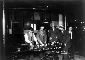RENO: GAMBLING, 1910. Men placing bets on an overland roulette game at a casino in Reno