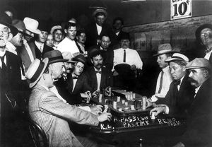 RENO: GAMBLING, 1910. Spectators observing a game of faro at a casino in Reno, Nevada