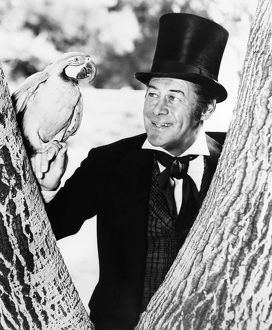 REX HARRISON (1908-1990). English actor. In the title role of the film, 'Dr. Dolittle