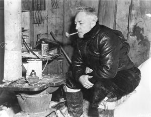 RICHARD EVELYN BYRD (1888-1957). American polar explorer. Trying his old corncob pipe