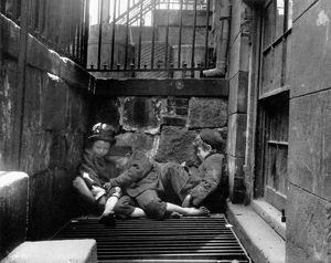 RIIS: NEW YORK, 1901. Young street Arabs sleeping on a steam grate from an underground