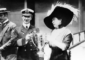 ROSTRON AND BROWN, 1912. Margaret 'Molly' Brown presenting a trophy cup to