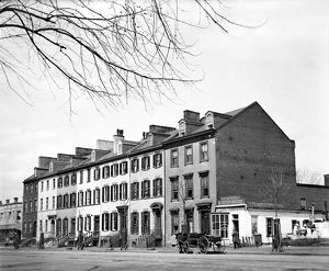 ROW HOUSES, c1919. Row houses identified as farm buildings, with the A
