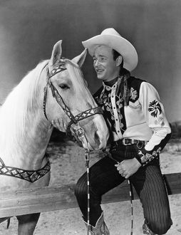 ROY ROGERS (1912-1998). © Leonard Slye. American singing cowboy actor. Photographed with his horse Trigger.