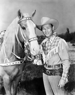 ROY ROGERS (1912-1998). Né Leonard Slye. American singing cowboy actor. With his horse, Trigger.