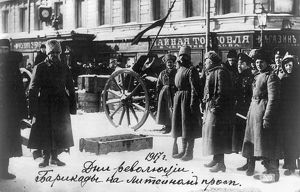 RUSSIAN REVOLUTION, 1917. People in front of a barricade on a street in the Liteinyi