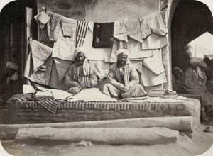 SAMARKAND: VENDOR, c1870. A vendor of shirts and other clothes at a bazaar in the