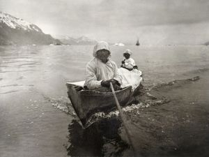 SEAL HUNTERS, c1899. Two Inuit seal hunters in a canoe on the Glacier Bay, Alaska. Photograph by Edward S. Curtis, c1899.