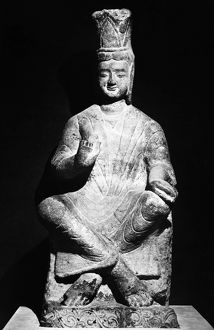 Seated stone figure of a bodhisattva, from the Yungang Grottoes, Shanxi province