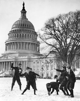 Senate page boys in a snowball fight in front of the U.S. Capitol in Washington, D