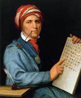 SEQUOYA (1770?-1843). Native American scholar, with his printed Cherokee alphabet