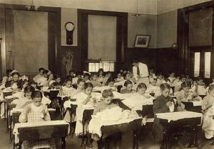 SEWING CLASS, 1909. Working girls learning sewing at the Vocational Hancock School
