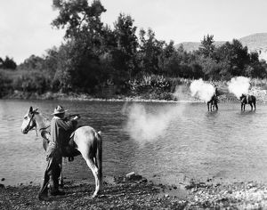 SHOOTOUT, c1910. A shootout between two Native Americans and a white man