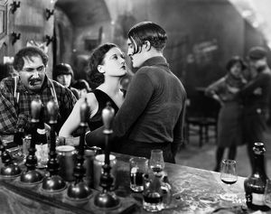 SILENT FILM: PARIS, 1926. Joan Crawford and Douglas Gilmore at the bar of an 'Apache Den' in 'Paris,' 1926.