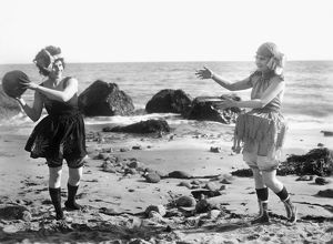 SILENT FILM STILL: BEACH.