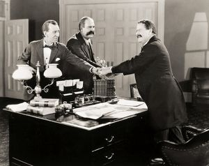 SILENT FILM STILL: OFFICES.