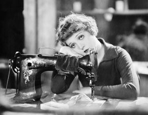 SILENT FILM STILL: SEWING.