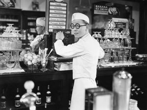 SILENT FILM STILL: STORES. American actor Kenneth Howell in a scene from a silent film.