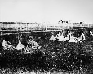 SIOUX GIRLS, c1892. A group of Sioux Native American girls playing with toy tipis