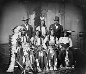 SIOUX MEN, c1875. Group of Sioux men. Back row, left to right: Joe Merrivale, Young