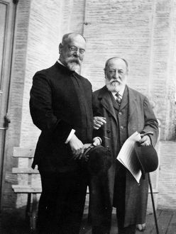 SOUSA & SAINT-SAENS, c1915. American composer John Philip Sousa (left) with French composer and pianist Camille Saint-Saens. Photograph, c1915.