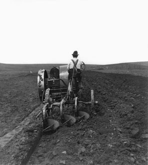 SOUTH DAKOTA: FARMING. A farmer plowing a field on the South Dakota prairie. Stereograph