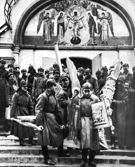 SOVIET ANTI-RELIGION POLICY. Red Army soldiers looting a convent, c1920.