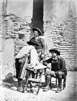 SPAIN: COWBOYS, c1875. Three Spanish cowboys around a outdoor table in Cordoba, Spain