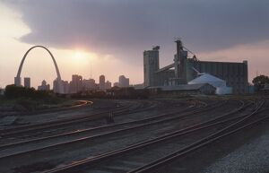 ST. LOUIS: FREIGHT YARD. Twilight view of a freight yard near a grain storage facility in St