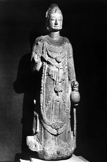 Standing stone figure of a bodhisattva, with traces of polychrome. Height: 47 in