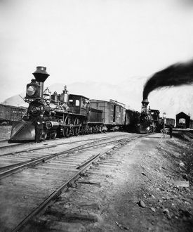 STEAM LOCOMOTIVES. Steam locomotives at a depot. Photograph, mid to late 19th century