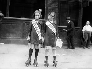 STRIKE, c1915. Two young strike sympathizers on rollerskates, probably in New York City