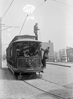 STRIKEBREAKERS, 1916. Strikebreakers on top of a broken streetcar during a streetcar