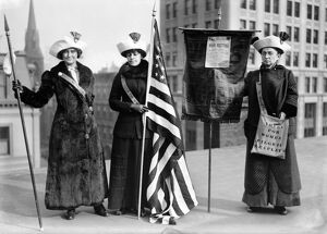 SUFFRAGETTES, c1910. Three women photographed on a Brooklyn rooftop before a demonstration