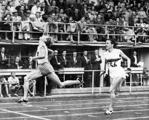 SUMMER OLYMPICS, 1952. Fanny Blankers-Koen of the Netherlands beating Marga Petersen
