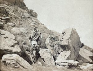 TEXAS: COWBOYS, c1908. Two cowboys on horseback traveling down a rocky hillside