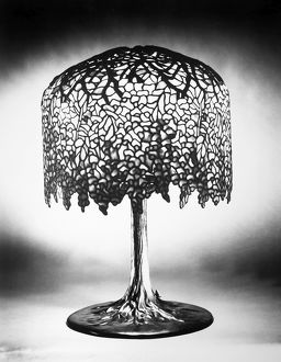 TIFFANY LAMP. Wisteria leaded glass and bronze table lamp in the form of a tree