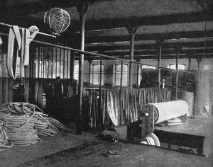 TIRE FACTORY, 1897. Canvas-cutting machinery at the Beeston pneumatic tire factory