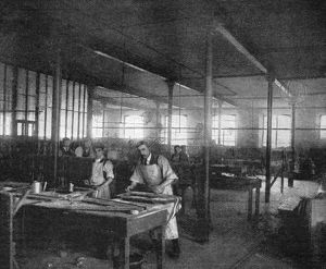 TIRE FACTORY, 1897. Workers making pockets at the Beeston pneumatic tire factory